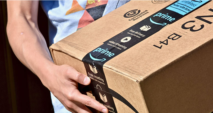 guy-carrying-amazon-prime-box-feature
